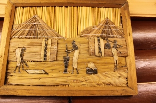 African picture made from bamboo, with banana leaves for the natives dresses. Picture sent as a gift from South Africa